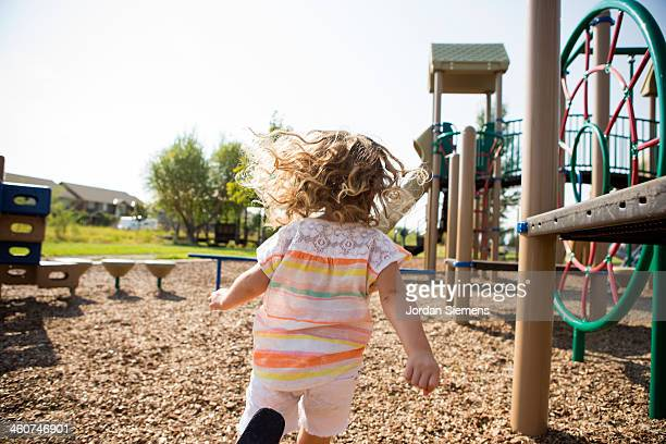 Kid running through playground.