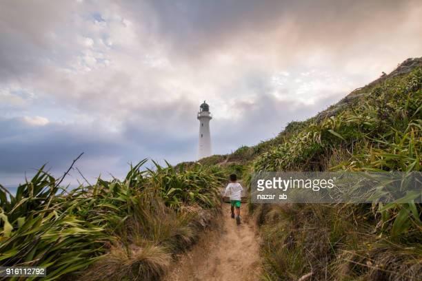 Kid running towards Castlepoint Lighthouse.