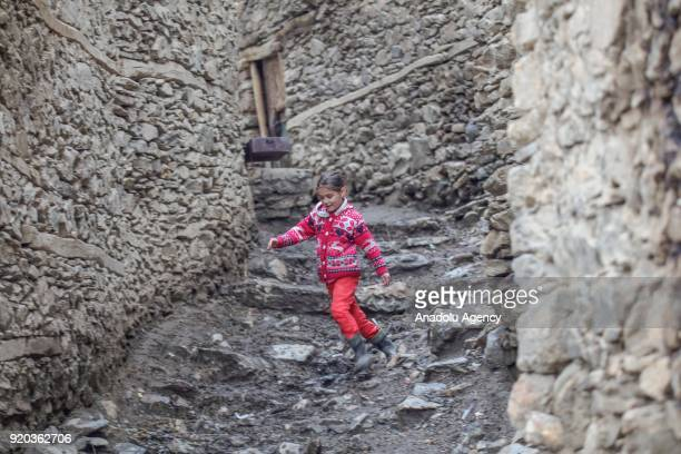 A kid runs around between stone houses at a village at Hizan district in the southeastern province of Bitlis Turkey on February 18 2018 Most of the...