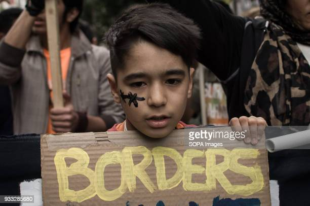 A kid seen at the demonstration Demonstration for the International action day against racism fascism war and poverty hosted in Athens