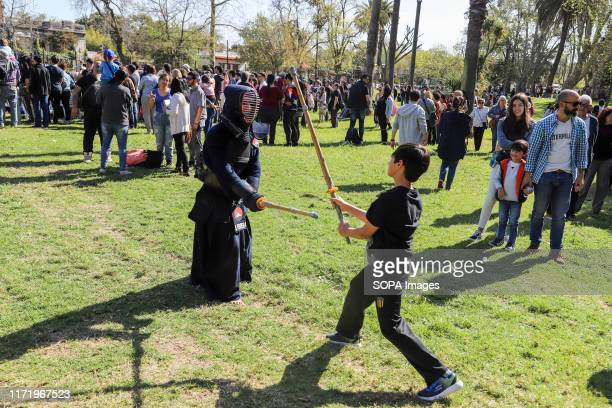 Kid seen learning Kendo with an instructor during the Japan Fest 2019 in Montevideo. Every year, the Japanese Embassy in Uruguay organizes the Japan...