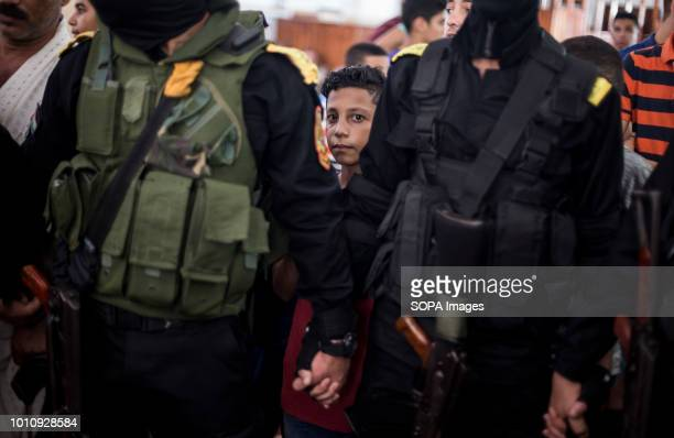 A kid seen next to fighters from Al Aqsa Martyrs brigades the armed wing of the Palestinian Fatah movement during the funeral Funeral of Ahmed Yaghi...