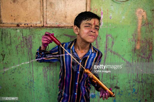 A kid seen playing with colours during the celebration Holi known as the festival of colour is an ancient Hindu spring festival which is now...