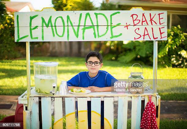 kid selling lemonade - lemon soda stock pictures, royalty-free photos & images