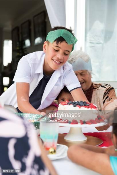 Kid sets pavlova on table