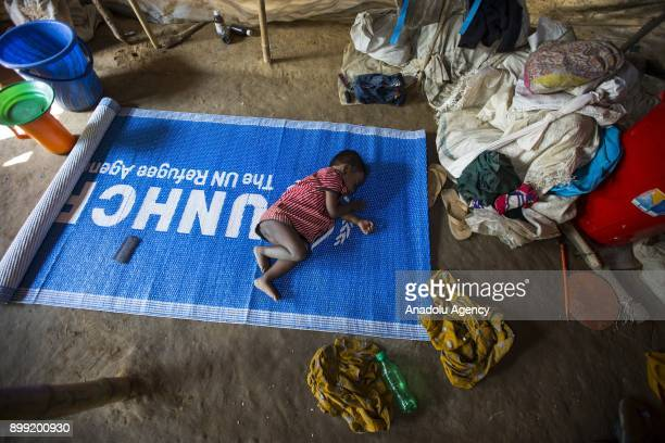 COX'S BAZAR BANGLADESH DECEMBER 27 A kid sleeps on an United Nations High Commissioner for Refugees mat on the floor at a refugee camp in Cox's Bazar...