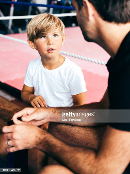 Kid talks to boxing mentor