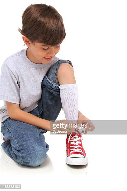 Kid tying his shoes