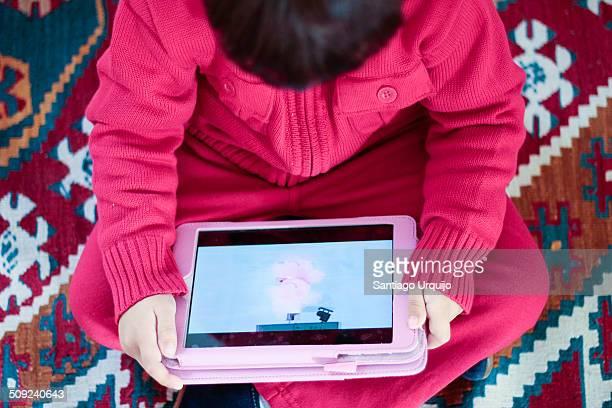 Kid watching a film on digital tablet