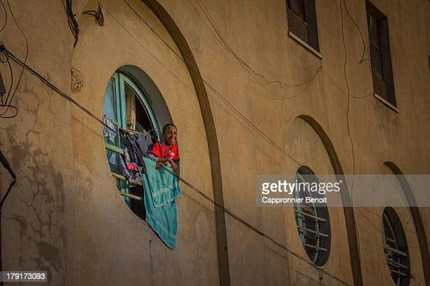 CONTENT] Kid watching the street from the window of an artdeco building in Asmara
