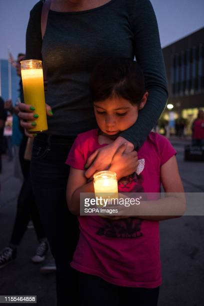 A kid with a lit candle during the protest Over one thousand people gathered in San Ysidro near the US Mexico border to protest against treatment of...