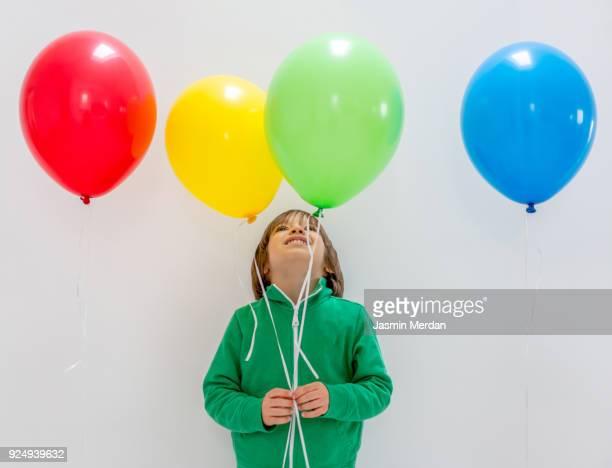 kid with balloons - flying solo after party bildbanksfoton och bilder
