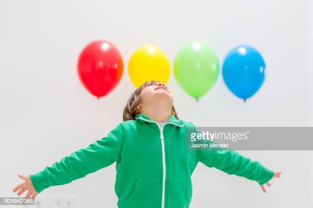 Kid with balloons