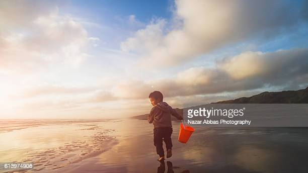 Kid with Bucket at Beach.