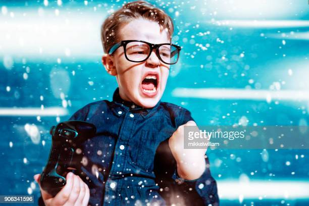 kid with game controller wins sport match and cheers - achievement stock pictures, royalty-free photos & images