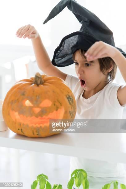 Kid with Halloween pumpkin