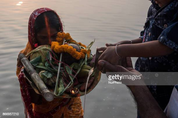 A kid with his father celebrating the festival of chhath puja in kolkata west Bengal on October 262017