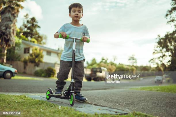 Kid with his push bike.