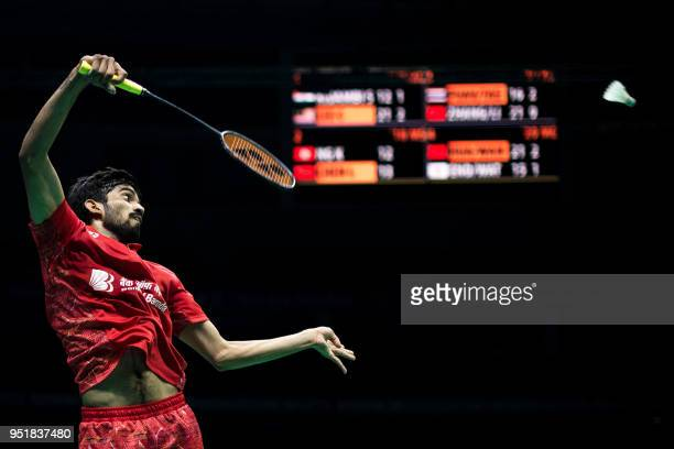 Kidambi Srikanth of India hits a return against Lee Chong Wei of Malaysia during their men's singles quarterfinals match at the 2018 Badminton Asia...