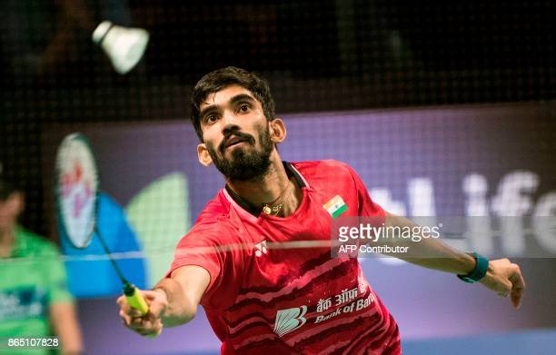 Kidambi Srikanth of India hits a return to Lee Hyun Il of Korea during their Men's Singles final match at the Danish Open badminton tournament in...