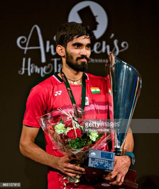 Kidambi Srikanth of India poses on the podium with his trophy after winning the Men's Singles final match against Lee Hyun Il of Korea at the Danish...