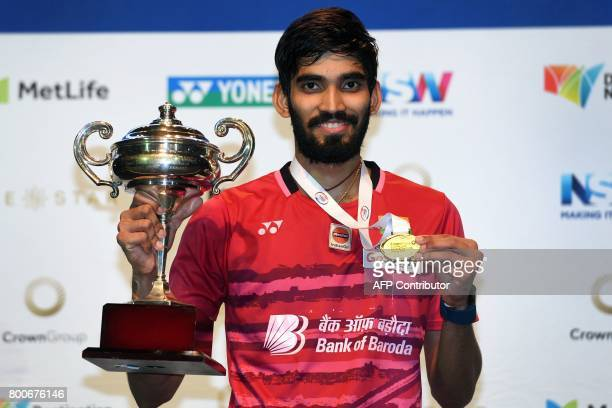 Kidambi Srikanth of India poses with the winner's trophy after defeating Chen Long of China in the Australian Open men's singles badminton final in...