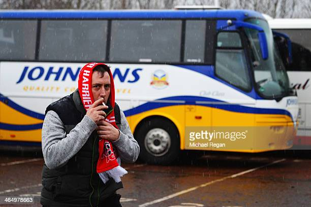 Kidderminster Harriers fan arrives in the wet conditions for the FA Cup Fourth Round match between Sunderland and Kidderminster Harriers at the...