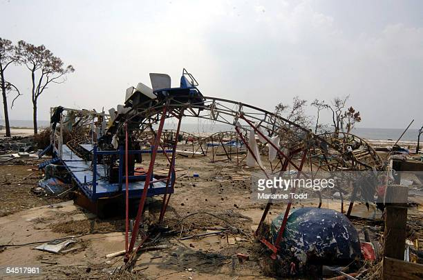 A kiddie roller coaster at Coast Magic sits damaged along Highway 90 on September 4 2005 in Biloxi Mississippi Before Hurricane Katrina hit workers...