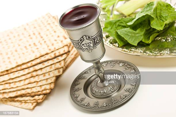kiddush cup, seder plate and matzo for passover - passover seder plate stock pictures, royalty-free photos & images