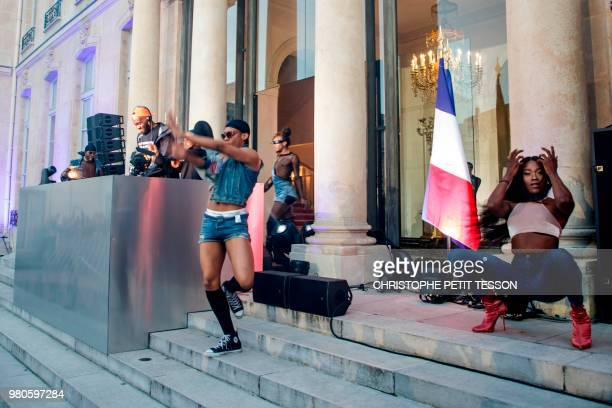 DJ Kiddy Smile and dancers perform during the annual 'Fete de la Musique' in the courtyard of the Elysee Palace in Paris on June 21 2018