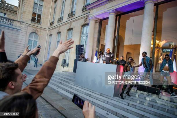 DJ Kiddy Smile and dancers play music during the 'Fete de la Musique' the music day celebration in the courtyard of the Elysee Presidential Palace in...