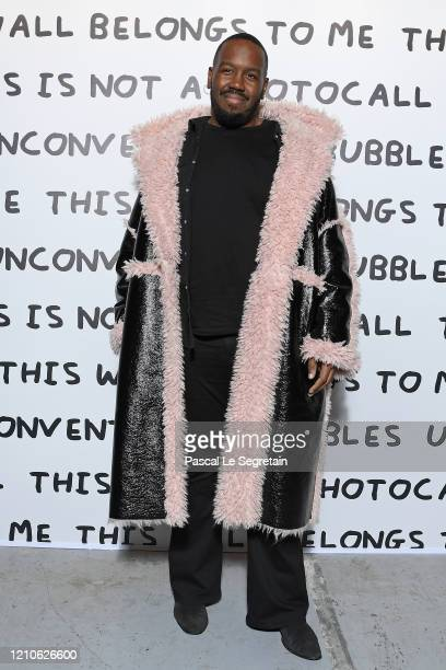 Kiddy Smile attends the Ruinart David Shrigley Unconventional Bubbles Exhibition photocall at Opera Bastille on March 05 2020 in Paris France