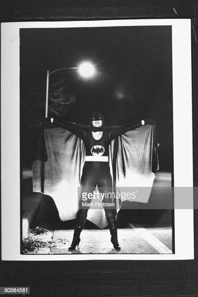 Kid-mischief vigilante/housewife Vicki Graswich posing at night in her Batman costume as a self-designated Batman, who counsels kids to stay home at...
