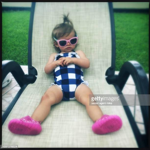 kidn on beach chair
