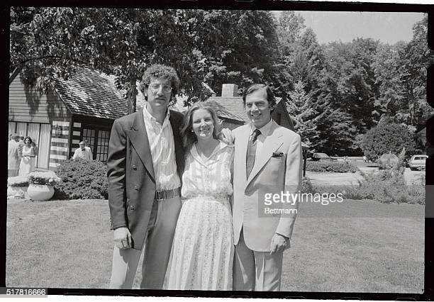 Kidnap victim Samuel Bronfman II chats with his father Seagram whiskey magnate Edgar M Bronfman and his bride the former Georgiana Eilea Webb...