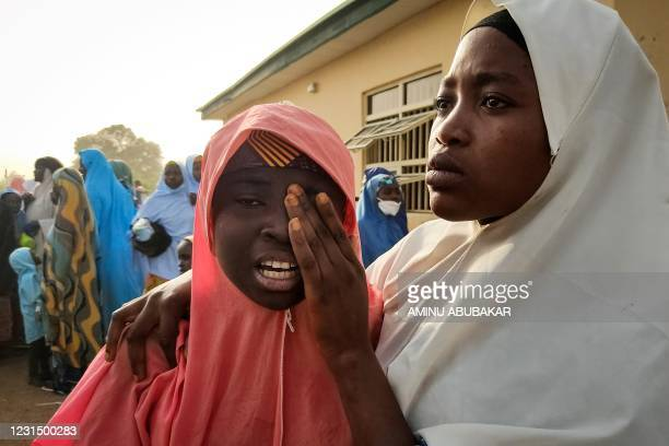 Kidnapped girl, reacts as she reunites with a family member in Jangebe, Zamfara state, on March 3, 2021 after they were kidnapped from a boarding...