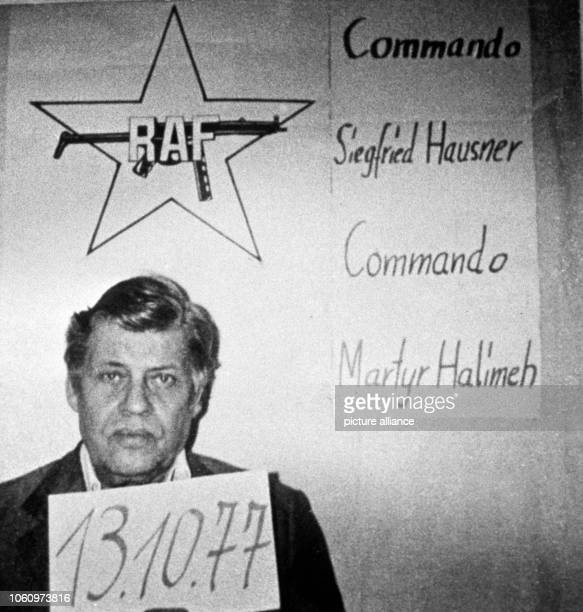 Kidnapped president of the employer's association Hanns Martin Schleyer below the logo of the RAF Commando Siegfried Hausner and martyr Halimeh...