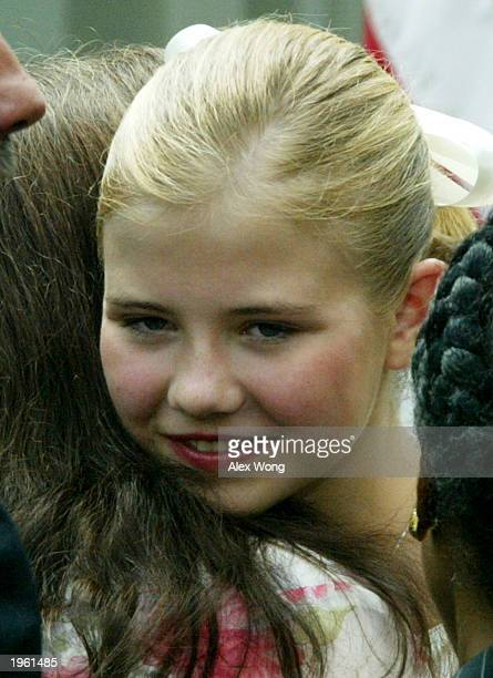 Kidnapped victim Elizabeth Smart gets a hug from Donna Norris, the mother of Amber Hagerman, April 30, 2003 at the Rose Garden of the White House in...