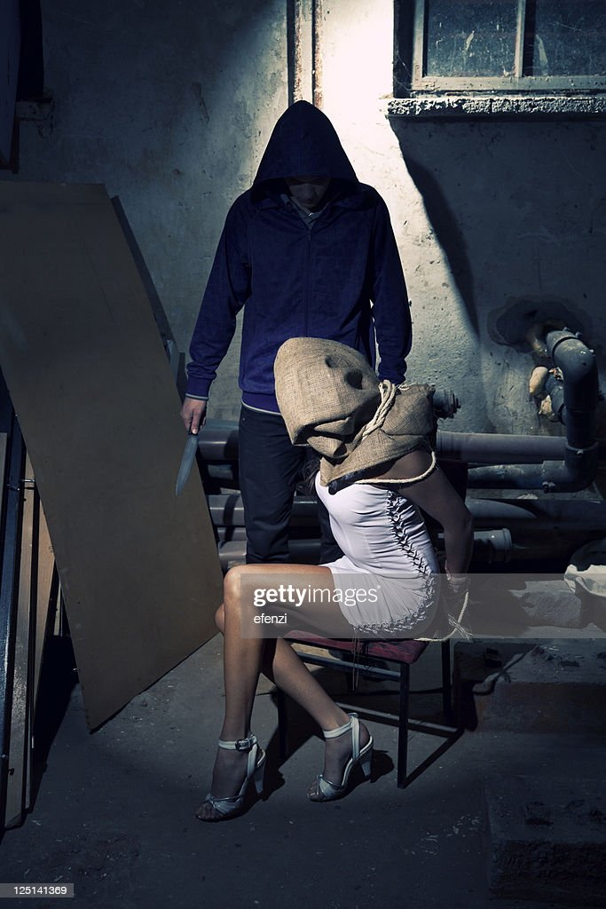 Kidnapper With His Hostage : Stock Photo