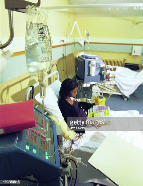 Kidney Dialysis Machine on Hospital Ward Patient in bed receiving treatment Royal London Hospital Renal Unit