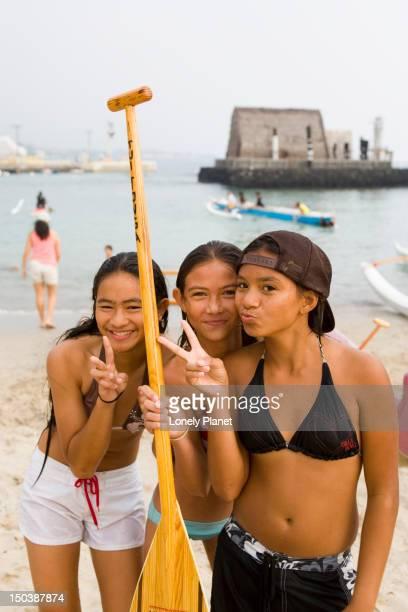 Kids acting up for the camera on Kamekahonu Beach, Kailua Kona.