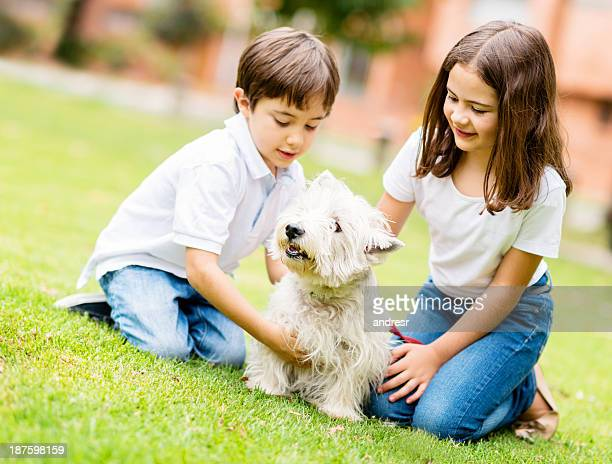 kids adopting a puppy - young animal stock pictures, royalty-free photos & images