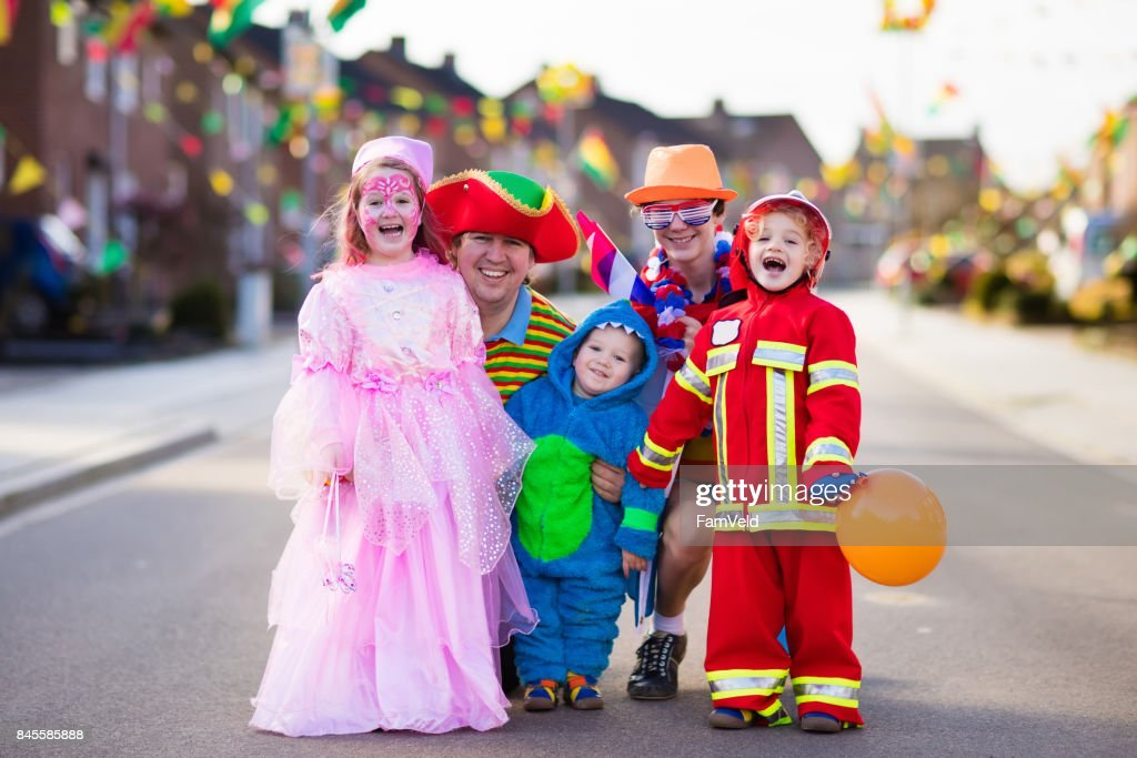 Kids and parents on Halloween trick or treat : Stock Photo