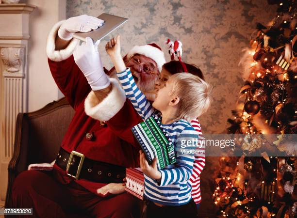 kids and santa using digital tablets - vladgans or gansovsky stock pictures, royalty-free photos & images