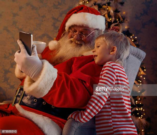 kids and santa using mobile - vladgans or gansovsky stock pictures, royalty-free photos & images