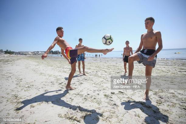 Kids are playing football at the beach during the FIFA U-20 Women's World Cup France 2018 on August 3, 2018 in Concarneau, France.