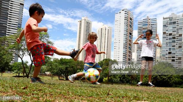 Kids are playing football in a public park on October 24 2019 in Goiania Brazil