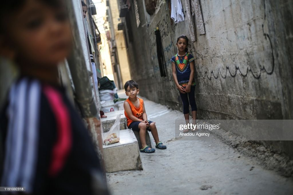 Kids are seen at Al-Shati Palestinian refugee camp in Gaza