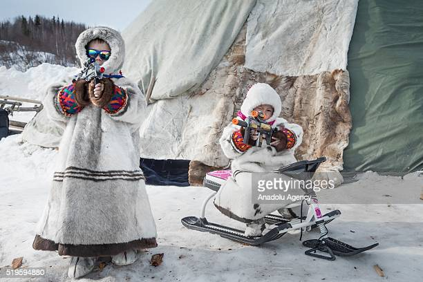 Kids are seen before the race on the Reindeer Herders Day in the village of Aksarka in the center Priuralsky district of YamaloNenets Autonomous...