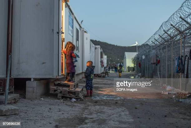 Kids are seen standing next to a door way of a housing unit in the camp. Moria is the largest refugee camp on the island which has previously been...